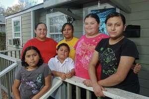 Susana Saldana, 9, from left, Maria Tamez, Juan Saldana, 6, Esmeralda Chavez, 16, Maria Saldana, 11, and Estela Saldana, 12, are looking forward to the little things of Christmas.