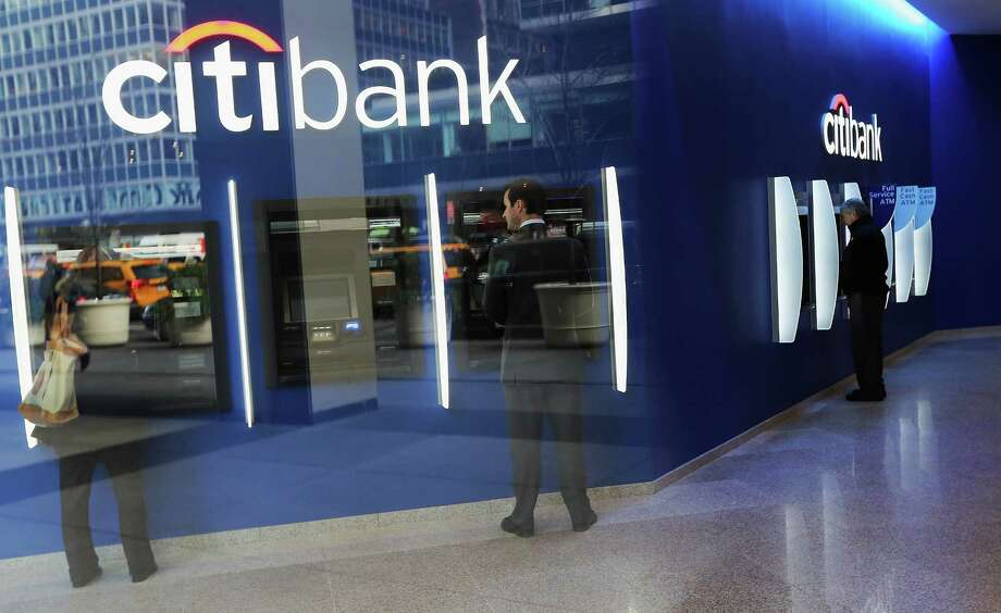 People use ATM's at Citibank headquarters in Manhattan on December 5, 2012 in New York City. Citigroup Inc. today announced it was laying off 11,000 workers, about 4 percent of its workforce, in a move to slash costs. Photo: Mario Tama, Getty Images / 2012 Getty Images