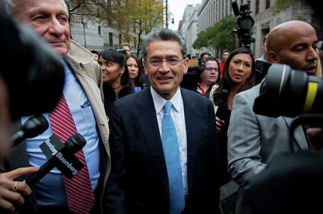 Rajat Gupta, center, leaves federal court in New York on Wednesday, Oct. 24, 2012 after the former Goldman Sachs and Procter & Gamble Co. board member was sentenced Wednesday to 2 years in prison for feeding inside information about board dealings with a billionaire hedge fund owner who was his friend. Gupta can remain free on bail pending the appeal of his insider trading conviction, a federal appellate panel said Tuesday, Dec. 4. Photo: Craig Ruttle, Craig Ruttle/Associated Press / Associated Press