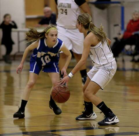 Mike Ross Connecticut Post freelance -Newtown's #10 Sarah Lynch gives heavy defense pressure against Lauralton Hall's # 14 Michelle DeSantis during the first half on Wednesday evening match up. Photo: Mike Ross / Connecticut Post Freelance