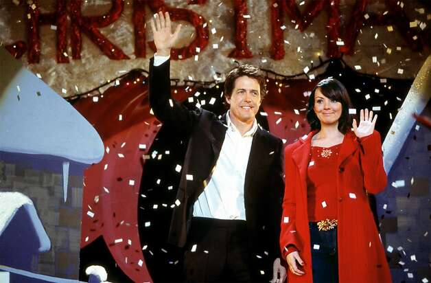 "The prime minister (Hugh Grant) and his love interest (Martine McCutcheon) are caught off guard at a Christmas pageant in ""Love Actually."" Photo: Ho, HO"