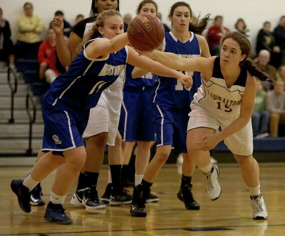 Mike Ross Connecticut Post freelance -Newtown's #14 Maddy Good and Lauralton Hall's # 15 Maureen Connolly reach for a loose ball during first half action on Wednesday evening match up. Photo: Mike Ross / Connecticut Post Freelance