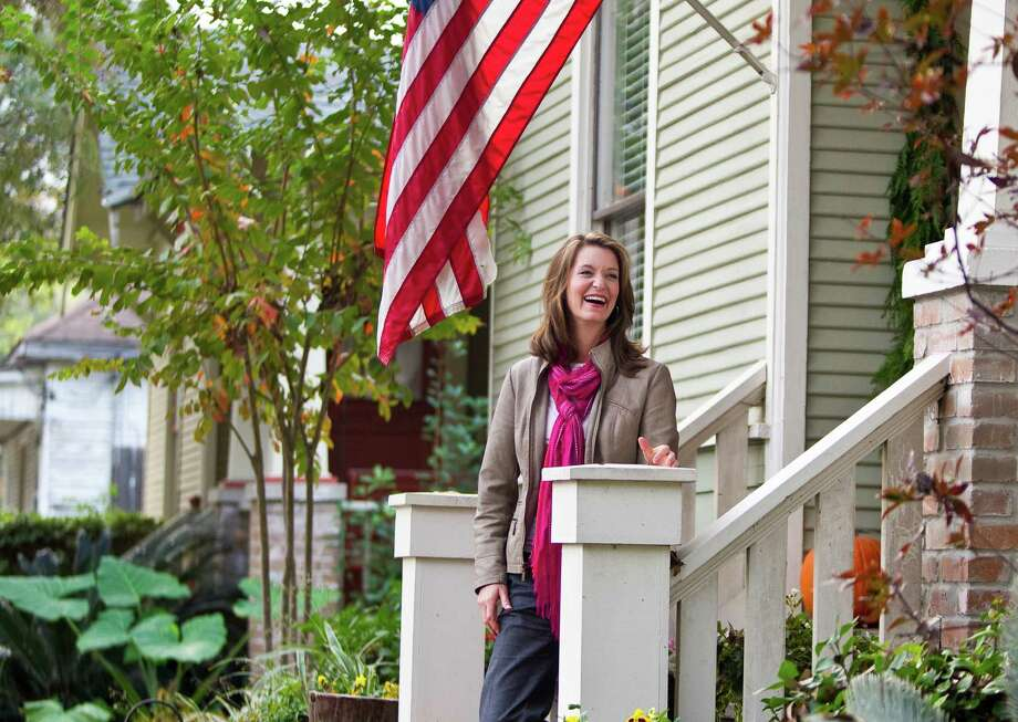 Resident Wendy Parker is happy efforts to obtain historic district status for Germantown were successful. The modernization of Houston and squabbles over property owners' rights could doom new districts. Photo: Nick De La Torre, Staff / © 2012  Houston Chronicle