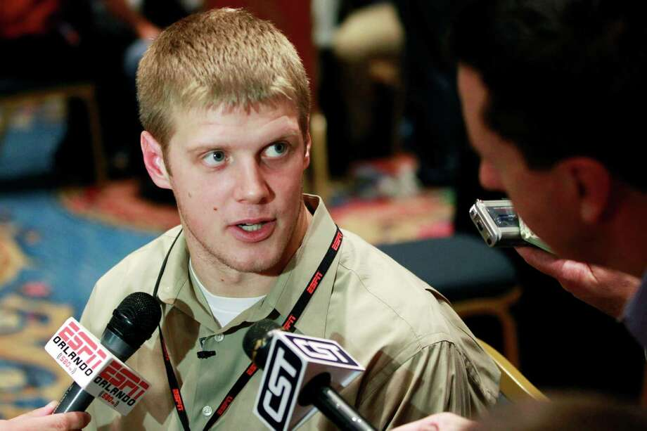 Kansas State quarterback Collin Klein answers questions during an interview at a media event prior to the College Football Awards show, Wednesday, Dec. 5, 2012, in Lake Buena Vista, Fla. (AP Photo/John Raoux) Photo: John Raoux, STF / AP