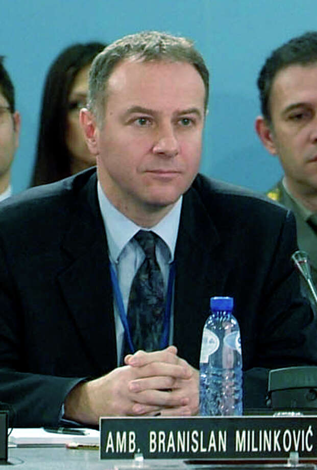 In this photo made available by NATO, in this Dec. 14, 2006 file photo, Serbia's Ambassador to NATO Branislav Milinkovic is seen during a meeting at NATO headquarters in Brussels, Belgium. A Serbian government statement said Wednesday Dec. 5, 2012,  that 52-year old Milinkovic committed suicide by leaping from a busy parking garage platform at Brussels Airport on Tuesday night.  A diplomat who could not be identified because he was not authorized to speak to the media said Milinkovic suddenly jumped from the 8- to 10-meter-high (26- to 33-foot-high) platform while waiting with the Serbian delegation for foreign ministry officials due to hold talks with NATO officials. (AP Photo/NATO, file) Photo: NATO