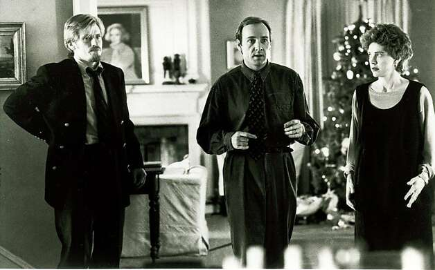 "On Christmas Eve, a burglar (Denis Leary, left) must take a bickering couple (Kevin Spacey and Judy Davis) hostage in the comedy ""The Ref."" Photo: Buena Vista Pictues 1994"