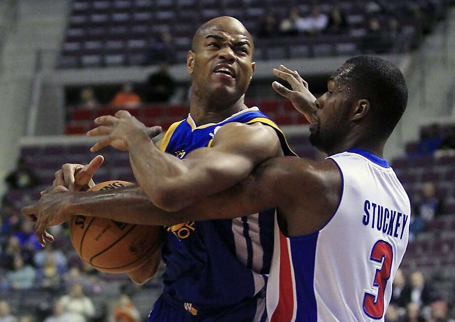 Detroit Pistons guard Rodney Stuckey (3) knocks the ball away from Golden State Warriors guard Jarrett Jack during the first quarter of an NBA basketball game at the Palace of Auburn Hills, Mich., Wednesday, Dec. 5, 2012. (AP Photo/Carlos Osorio) Photo: Carlos Osorio, Associated Press