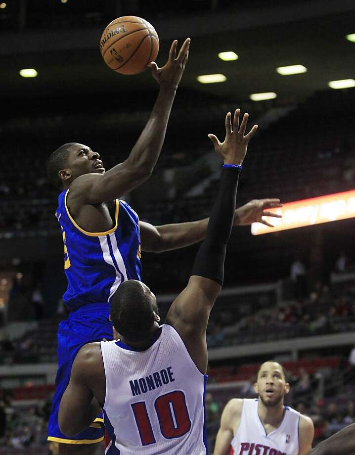 Golden State Warriors center Festus Ezeli, top, of Nigeria, shoots over Detroit Pistons center Greg Monroe (10) during the first quarter of an NBA basketball game at the Palace of Auburn Hills, Mich., Wednesday, Dec. 5, 2012. (AP Photo/Carlos Osorio) Photo: Carlos Osorio, Associated Press
