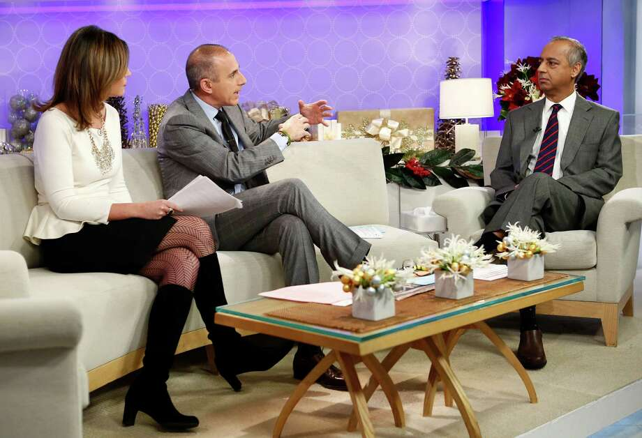 "This image released by NBC shows co-hosts Savannah Guthrie, left, and Matt Lauer, center, during an interview with freelance photographer R. Umar Abbasi on NBC News' ""Today"" show, Wednesday, Dec. 5, 2012 in New York. On Monday, Abbasi took a photo of a man who was pushed onto a New York subway track and killed after being hit by a train. The New York Post published the photo on its front page Tuesday showing the man with his head turned toward the oncoming train. The headline read in part: ""This man is about to die."" (AP Photo/NBC, Peter Kramer) Photo: Peter Kramer"