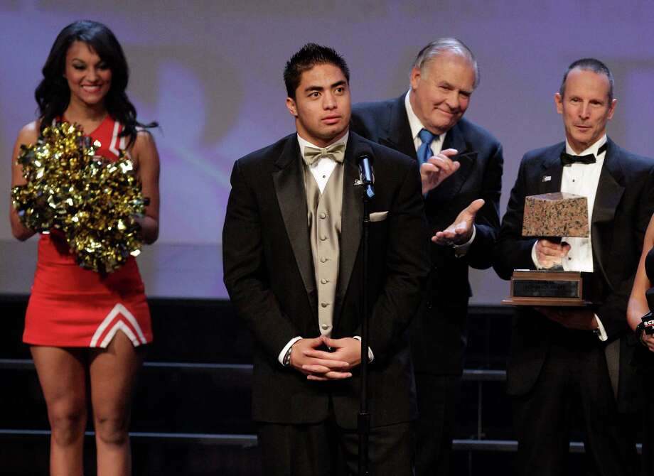 University of Notre Dame inside linebacker Manti Te'o, center,  speaks after winning the Rotary Lombardi Award at the 43rd Rotary Lombardi Award ceremony at the Houston Hobby Center, 800 Bagby Street, Wednesday, Dec. 5, 2012, in Houston. Photo: Melissa Phillip, Houston Chronicle / © 2012 Houston Chronicle