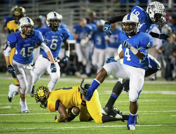 Navasota's Franterric Powell (4) celebrates a defensive stop against La Marque's during the first half in high school  Class 3A Division II football playoff action at Woodforest Bank Stadium Friday, Nov. 30, 2012, in Shenandoah.  Smiley N. Pool / Houston Chronicle ) Photo: Smiley N. Pool, Staff / © 2012  Houston Chronicle
