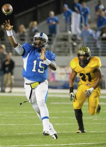 Navasota quarterback Kadarius Baker (15) throws a 17-yard touchdown pass to to Demarcus Lee as La Marque's Jeff Sowell gives chase during the first half in high school  Class 3A Division II football playoff action at Woodforest Bank Stadium Friday, Nov. 30, 2012, in Shenandoah.  Smiley N. Pool / Houston Chronicle ) Photo: Smiley N. Pool, Staff / © 2012  Houston Chronicle