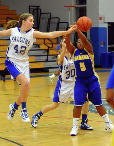 Fairfield Ludlowe's #42 Trish Auray, left, knocks away the ball from Harding's #5 Brae Stewart, during girls basketball action in Fairfield, Conn. on Wednesday December 5, 2012. Photo: Christian Abraham / Connecticut Post