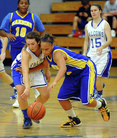 Fairfield Ludlowe's #23 Caroline Pangallo, left, tries to gain control of the ball after knocking it away from Harding's #12 Amber Crawford, during girls basketball action in Fairfield, Conn. on Wednesday December 5, 2012. Photo: Christian Abraham / Connecticut Post