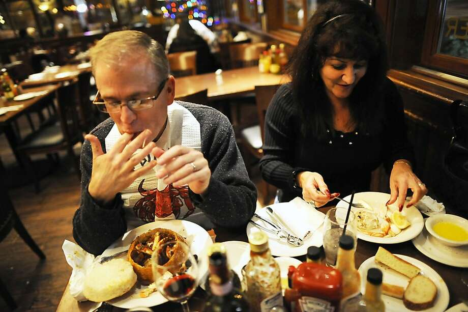 John Gronley(L) and Dolores Manriquez of San Jose are seen enjoying their orders of crab at Capurro's Restaurant in San Francisco, CA Wednesday December 5th, 2012. Photo: Michael Short, Special To The Chronicle