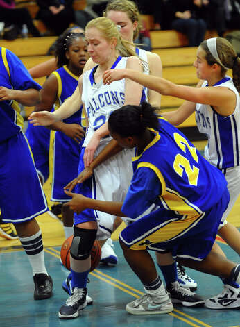 Fairfield Ludlowe's #20 Sydney Foulk, center, looses track of the ball, during girls basketball action against Harding in Fairfield, Conn. on Wednesday December 5, 2012. Photo: Christian Abraham / Connecticut Post