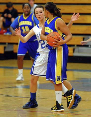 Fairfield Ludlowe's #23 Caroline Pangallo and Harding's #12 Amber Crawford, during girls basketball action in Fairfield, Conn. on Wednesday December 5, 2012. Photo: Christian Abraham / Connecticut Post
