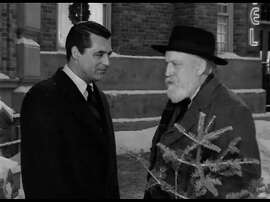 "Cary Grant as the angel Dudley and Monty Woolley as Professor Wutheridge in ""The Bishop's Wife."""