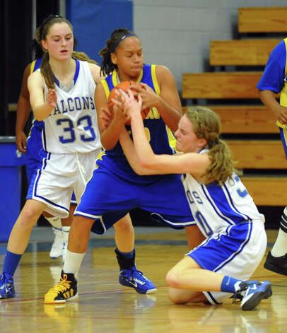 Fairfield Ludlowe's #30 Pauline Blatt, right, tries to steal the ball from Harding's #12 Amber Crawford, during girls basketball action in Fairfield, Conn. on Wednesday December 5, 2012. Photo: Christian Abraham / Connecticut Post