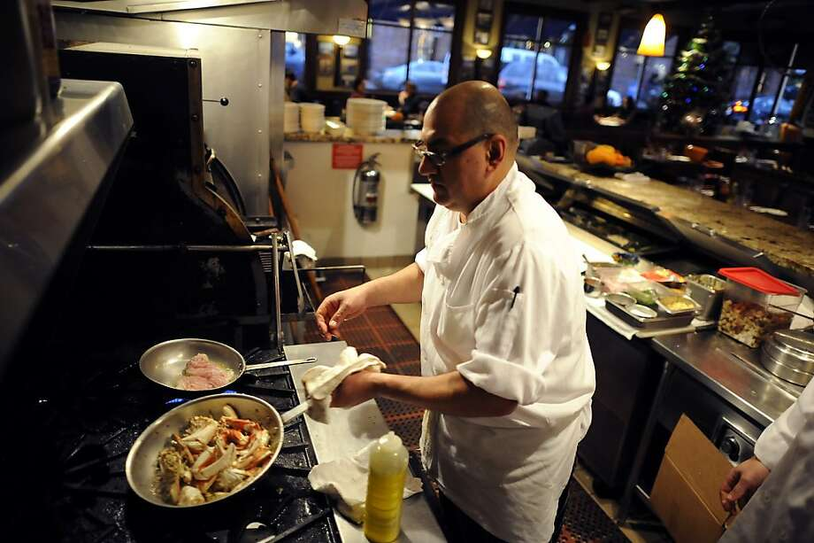 Sous Chef Arturo Gutierrez(L) works on an order of local crab the kitchen of Capurro's Restaurant at Fisherman's Wharf in San Francisco, CA Wednesday December 5th, 2012. Photo: Michael Short, Special To The Chronicle