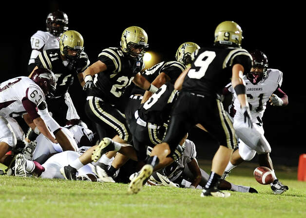 Central fumbles the ball for the third time in the half and recover to make a first down during the Nederland High School football game against Central High School in Nederland on Friday, November 9, 2012. Photo taken: Randy Edwards/The Enterprise Photo: Randy Edwards