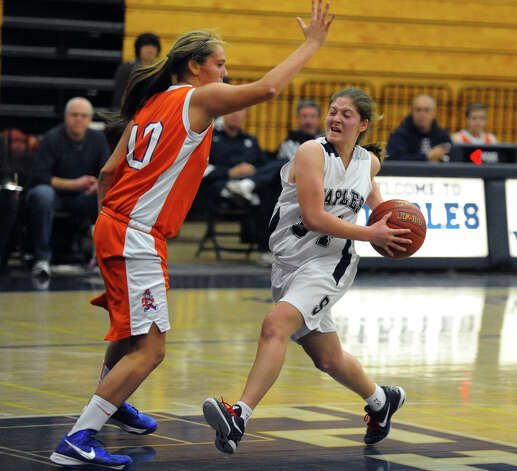 Staples' #34 Erica Stein drives the ball towards the basket as Danbury's #10 Allie Smith blocks, during girls basketball action in Westport, Conn. on Wednesday December 5, 2012. Photo: Christian Abraham / Connecticut Post