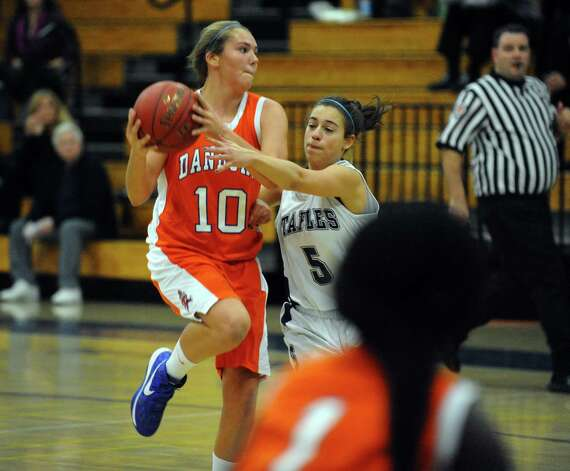Staples' #5 Allison April tries to block Danbury's #10 Allie Smith, during girls basketball action in Westport, Conn. on Wednesday December 5, 2012. Photo: Christian Abraham / Connecticut Post