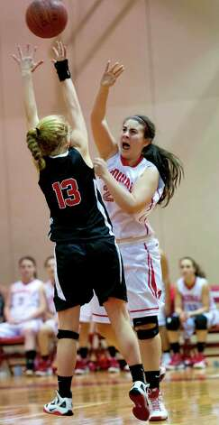 Greenwich high school's Rebecca Kural passes the ball over New Canaan high school's Elizabeth Miller in a girls basketball game played at Greenwich high school, Greenwich, CT on Wednesday December 5th, 2012. Photo: Mark Conrad / Stamford Advocate Freelance