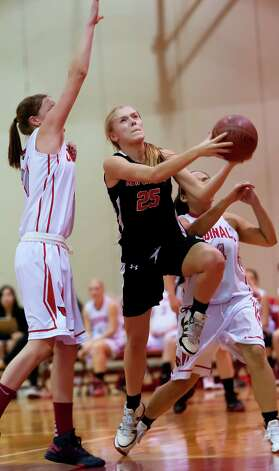 New Canaan high school's Kelly Armstrong goes up for a shot in a girls basketball game against Greenwich high school played at Greenwich high school, Greenwich, CT on Wednesday December 5th, 2012. Photo: Mark Conrad / Stamford Advocate Freelance