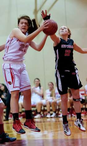 Greenwich high school's Jamie Kockenmeister and New Canaan high school's Elizabeth Miller fight for a rebound in a girls basketball game played at Greenwich high school, Greenwich, CT on Wednesday December 5th, 2012. Photo: Mark Conrad / Stamford Advocate Freelance