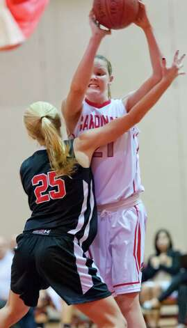 Greenwich high school's Abbie Wolf pulls down a rebound in a girls basketball game against New Canaan high school played at Greenwich high school, Greenwich, CT on Wednesday December 5th, 2012. Photo: Mark Conrad / Stamford Advocate Freelance