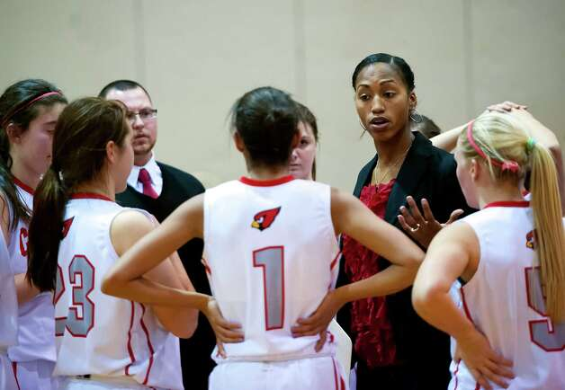 Greenwich high school girls basketball head coach, Chrys Hernandez, speaks to her team during a time out in a game against New Canaan high school played at Greenwich high school, Greenwich, CT on Wednesday December 5th, 2012. Photo: Mark Conrad / Stamford Advocate Freelance