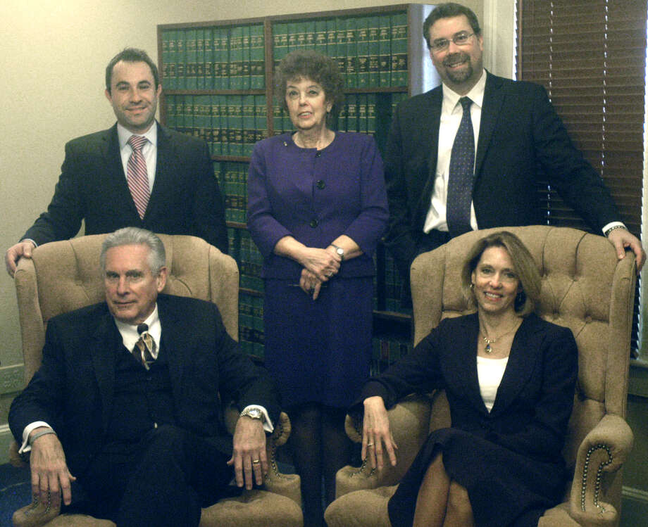 "Among the attorneys for Moots, Pellegrini, Arnold & Gronbach in New Milford are, from left to right, front row, Roland ""Lon"" Moots Jr. and Lynda Arnold; back row, David Albanese, Barbara Dratch and David Gronbach. Terry Pellegrini is absent from the photo. November 2012 Photo: Norm Cummings"
