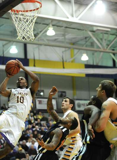 UAlbany's Mike Black goes in for a basket during their game against St. Francis in Albany , NY Wedne