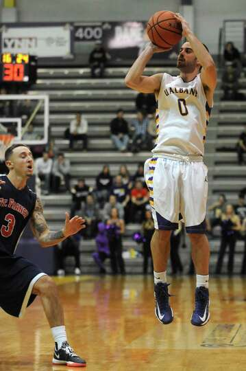 UAlbany's Jacob Iati shots a three point shot during their game against St. Francis in Albany , NY W