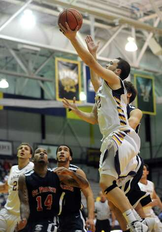 UAlbany's Peter Hooley goes to the basket during their game against St. Francis in Albany , NY Wednesday Dec. 5, 2012. .(Michael P. Farrell/Times Union) Photo: Michael P. Farrell