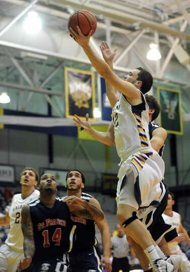 UAlbany's Peter Hooley goes to the basket during their game against St. Francis in Albany , NY Wedne