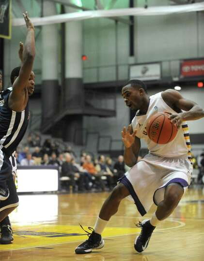 UAlbany's Mike Black brings the ball down the court during their game against St. Francis in Albany
