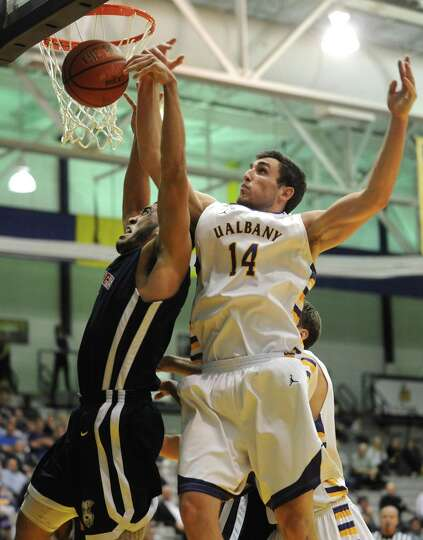 UAlbany's Sam Rowley goes up for a rebound during their game against St. Francis in Albany , NY Wedn