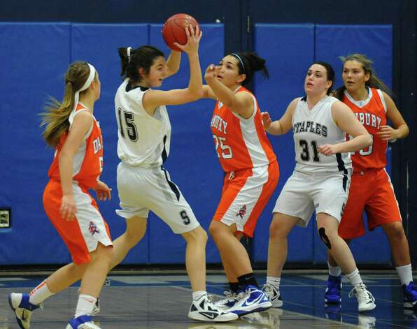 Staples' #15 Madeline Schemel gets pressure from Danbury's #25 Kayla Handberry, during girls basketball action in Westport, Conn. on Wednesday December 5, 2012. Photo: Christian Abraham / Connecticut Post