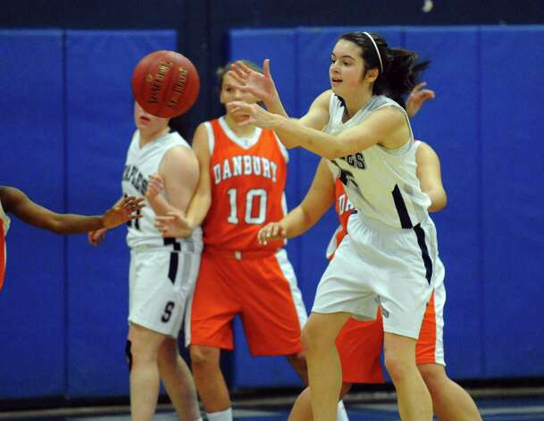 Staples' #15 Madeline Schemel passes the ball, during girls basketball action against Danbury in Westport, Conn. on Wednesday December 5, 2012. Photo: Christian Abraham / Connecticut Post