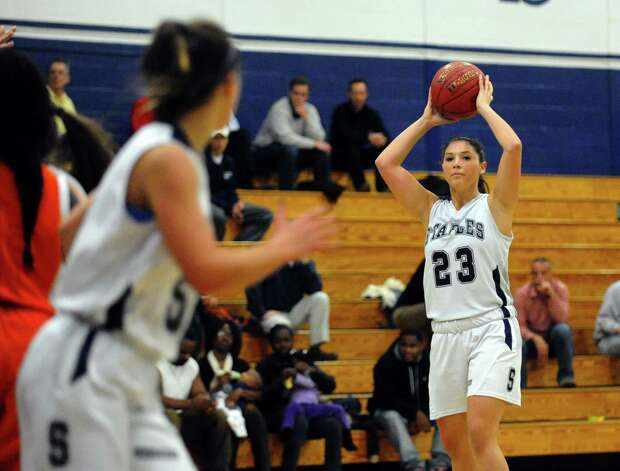 Staples' #23 Sophie deBruijn looks to pass the ball, during girls basketball action against Danbury in Westport, Conn. on Wednesday December 5, 2012. Photo: Christian Abraham / Connecticut Post