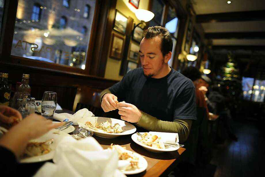 Justin Rydlek, who is visiting from Denver, Colorado digs into a plate of fresh crab at Capurro's Restaurant at Fisherman's Wharf in San Francisco, CA Wednesday December 5th, 2012. Photo: Michael Short, Special To The Chronicle