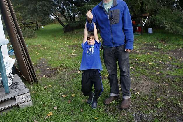 Benny Heath, 5 years old, taking a swing on his dad's arm at their cidery in Sebastopol, Calif., on Wednesday,  November 28, 2012. Photo: Liz Hafalia, The Chronicle