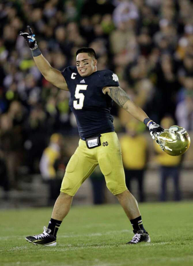 Notre Dame linebacker Manti Te'o, a Heisman finalist, is among the top defensive players in the country.        He has 103 total tackles, including 52 solo, 5 1/2 tackles for loss and seven sacks this season. Photo: Michael Conroy, STF / AP