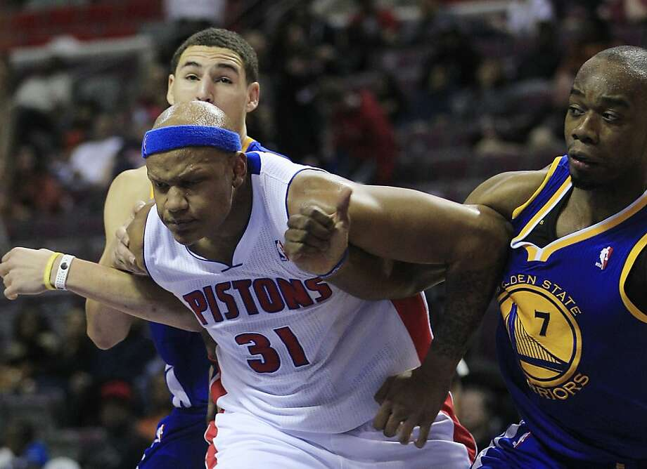 Detroit Pistons forward Charlie Villanueva (31) fights off Golden State Warriors guard Klay Thompson, left, and forward Carl Landry (7) during the second half of an NBA basketball game at the Palace of Auburn Hills, Mich., Wednesday, Dec. 5, 2012. (AP Photo/Carlos Osorio) Photo: Carlos Osorio, Associated Press