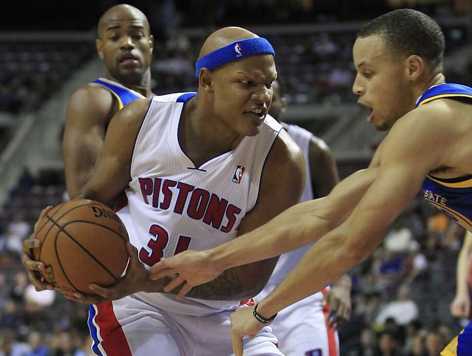 Detroit Pistons forward Charlie Villanueva (31) is guarded by Golden State Warriors guard Stephen Curry during the second half of an NBA basketball game at the Palace of Auburn Hills, Mich., Wednesday, Dec. 5, 2012. (AP Photo/Carlos Osorio) Photo: Carlos Osorio, Associated Press