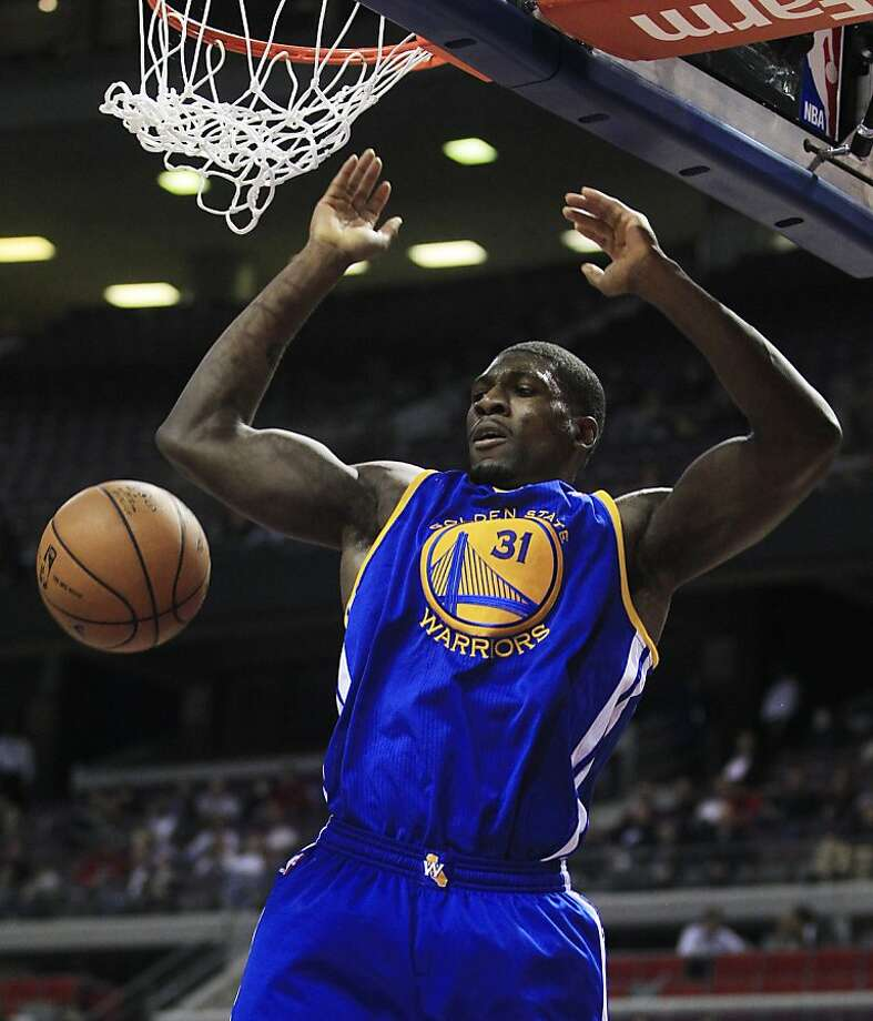 Golden State Warriors center Festus Ezeli (31) of Nigeria dunks during the first quarter of an NBA basketball game against the Detroit Pistons at the Palace of Auburn Hills, Mich., Wednesday, Dec. 5, 2012. (AP Photo/Carlos Osorio) Photo: Carlos Osorio, Associated Press