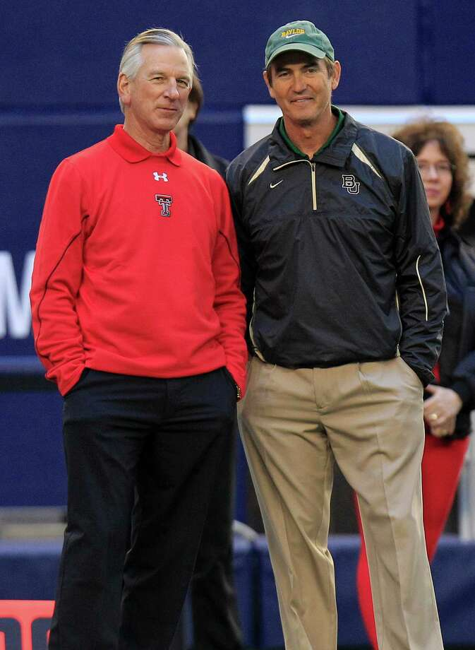 Texas Tech head coach Tommy Tuberville, left, and Baylor head coach Art Briles visit before their NCAA  college football game Saturday, Nov. 24, 2012, in Arlington, Texas.   (AP Photo/LM Otero) Photo: LM Otero, STF / AP