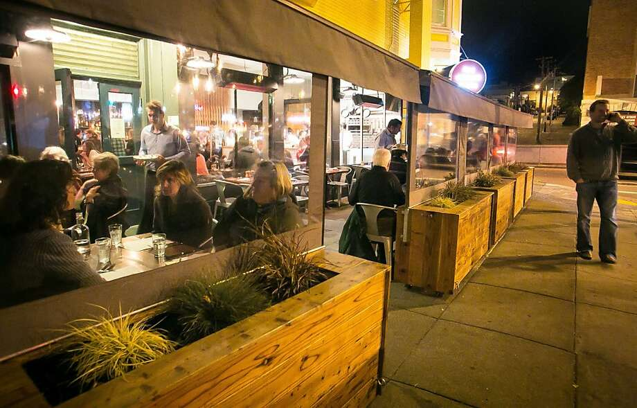Diners at San Francisco's Corner Store can eat in a heated covered patio off the sidewalk. Photo: John Storey, Special To The Chronicle